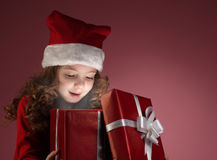Litle girl open gift box royalty free stock photography