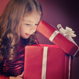 Litle girl open gift box Royalty Free Stock Photos