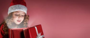 Litle girl open red gift box Royalty Free Stock Images