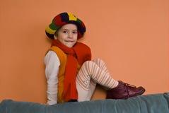 Litle Girl in orange dress  Stock Photos