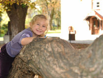 Litle girl playing in autumn park. Stock Image