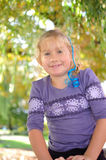 Litle girl playing in autumn park. Royalty Free Stock Image