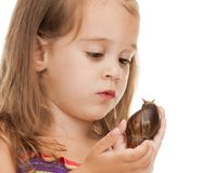 Litle girl with snail Royalty Free Stock Image