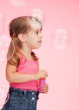 Litle girl with soap bubbles Stock Images