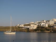 Litle sailing yacht anchored near a greece maritime town. Europe. Saaronic sea of Mediterranean area. Greece Ciclades islands. May 2014 Stock Image