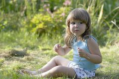 Litle scared girl in meadow Stock Photography
