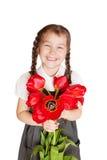 Litlle有郁金香花束的学校女孩  库存照片