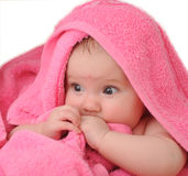Litlle baby. Portrait the child in red a towel Royalty Free Stock Images