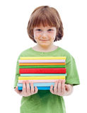 Litlle boy with freckles holding books Royalty Free Stock Photos