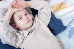 Litlle boy lying on bed Royalty Free Stock Photography