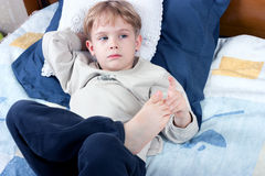 Litlle boy lying on bed Royalty Free Stock Photos