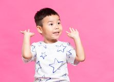Litlle boy raising hand up. Asian young little boy stock image