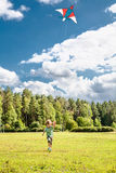 Litlle boy runs with kite Royalty Free Stock Image