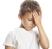Litlle cute blond  boy tired sad isolated Stock Images