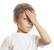 Litlle cute blond boy tired sad isolated close up Royalty Free Stock Photo