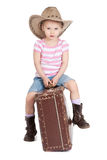 Litlle girl in a cowboy hat with a suitcase Royalty Free Stock Photography