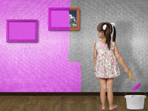 Litlle girl painting wall. Child girl doing repair, painting wall Stock Images