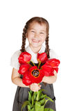 Litlle school girl with bouquet of tulips. Stock Photo