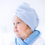Litlte beautiful girl in a bathrobe and towel Royalty Free Stock Image