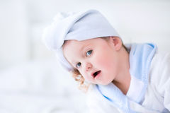 Litlte girl in a bathrobe and towel Royalty Free Stock Photos