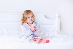 Litlte girl in a bathrobe and towel Royalty Free Stock Images