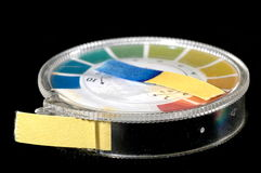 Litmus Paper. Close-up of an indicator paper with alkaline testing stock image