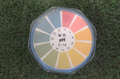 Litmus paper roll for testing acid level. On green background Stock Photography
