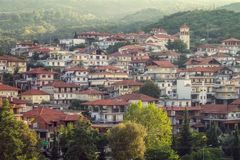 Litochoro view from castle to the city with buildings and road, Greece royalty free stock photography