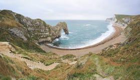 Litorale giurassico Dorest Regno Unito della spiaggia del portello di Durdle Immagini Stock Libere da Diritti
