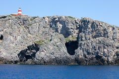 Litorale roccioso con il faro - isola di Giannutri Fotografia Stock