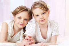 Litrtle sisters. Portrait of two beautiful little sisters looking at you Royalty Free Stock Photography
