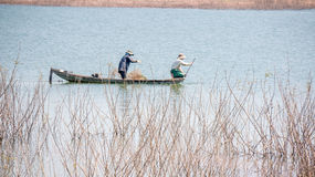 A litte boat and the yokefellow fishermen on the lake in DucTrong- LamDong- VietNam Royalty Free Stock Photography