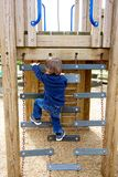 Litte boy climbing on playground Royalty Free Stock Photography