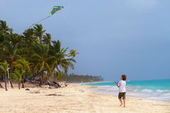 Litte boy playing with a kite on a tropical beach Royalty Free Stock Photography