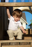 Litte boy playing on playground Stock Image
