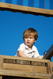 Litte boy playing on playground Royalty Free Stock Image