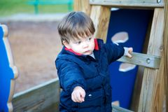Litte boy playing on playground Royalty Free Stock Photo