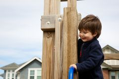 Litte boy playing on playground Royalty Free Stock Photography