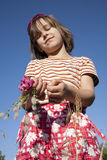 litte girl by play with the flowers Royalty Free Stock Photo