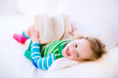 Litte girl reading Stock Photos