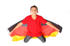 Littel Football-Fan. Male kid with a german flag stock photo