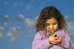Littel girl holding plant Stock Photography