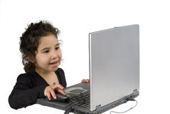 Littel girl with laptop computer Royalty Free Stock Image