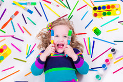 Littel girl with school art supplies Royalty Free Stock Photos