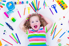 Littel girl with school supplies Stock Photos