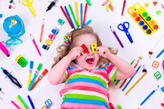 Littel girl with school supplies Stock Photography