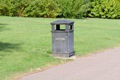 Litter bin in park Stock Image