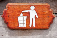 Litter bin sign. Carving from natural wood Stock Photos