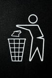 Litter bin symbol. Figure of person throwing garbage into a trash can Stock Photography
