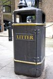 Litter - Black garbage can Stock Images